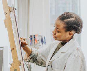 Soala Ajieka at work in Ashbourne Art Studio