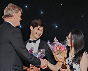 Xiaoyu Weng receives award from Ashboune Principal Mike Kirby