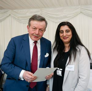 Collecting the award from Lord Lexden