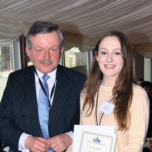 Grace Tucker receives award from Lord Lexden